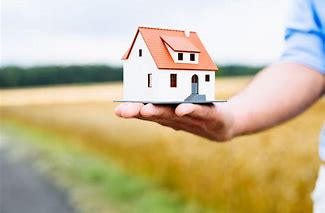 Photo of a man holding house